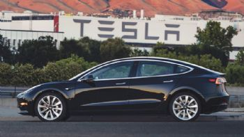 Tesla boosts Model 3 production