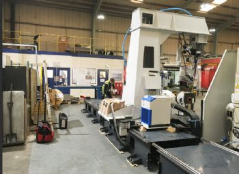 Third robotic welding system for AET
